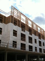 Framing work on the fourth story of apartments is under way.