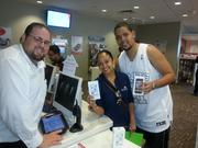 Miami Verizon Wireless sales rep Enrique Rodriguez with customers Nicola Carter and Kirby Edwards who bought three iPhone 5s models and one Samsung Galaxy S4 Friday morning. They arrived at the Kendall store at 2:30 a.m.