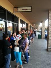 About 30 customers were waiting in line when the store opened at 8 a.m. The Verizon Pembroke Pines store had about 40.