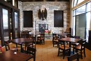 Firebirds' private dining room includes a fireplace, wall-mounted wine racks and, not pictured, a large video monitor for meetings and large TV.