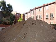 A big mound of dirt at 3220 Grace St. NW, future home to a seven-unit apartment building.