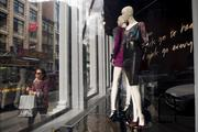 Pedestrians walk past mannequins in the window of a Bebe Stores Inc. shop in the shopping district of Soho in New York on Saturday, Sept. 14. Consumers views of the U.S. economic outlook deteriorated in September to the weakest level in a year.