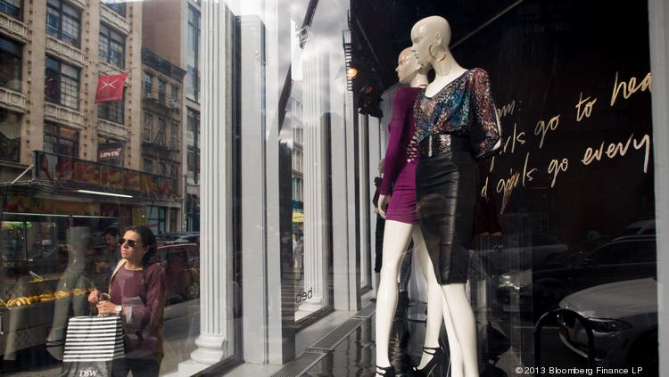 Pedestrians walk past mannequins in the window of a Bebe Stores Inc. shop in the shopping district of Soho in New York. Bebe is among the companies due to release earnings tomorrow.
