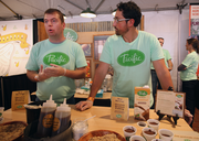 """Pacific Foods made a splash with its scrumptious roasted red pepper gazpacho and dairy-free chocolate pudding. The company gave away its concoctions during Feast Portland's Oregon Bounty Grand Tasting, at downtown's Pioneer Courthouse Square. During Thursday's Sandwich Invitational, """"People were trying to cast votes for our gazpacho as the best sandwich,"""" said Patrick Ramsey (left, with North's Kyle Stuart)."""