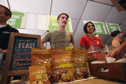 """Daniel Witte (left) and Masala Pop owner Neha Patel were inundated with food-lovers curious about the company's line of savory and spicy popcorns. The company, which ran a booth at the Feast Portland event in downtown Portland, recently landed shelf space in New Seasons Markets. """"We're a little bit of a different food company,"""" Witte said. """"We're having a great time here because we're between brewers [Laurelwood and Hopworks]. That's worked out well because we've been lately pairing our popcorn with different beers."""""""