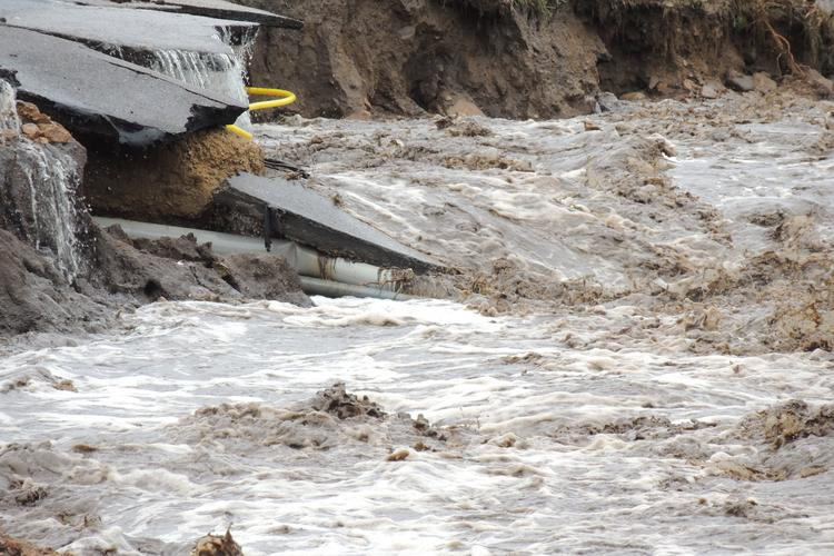 Colorado's unprecedented floods damaged natural gas lines, power poles and other equipment.