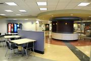 The building's new cafeteria is bright and airy, with plenty of space to socialize.