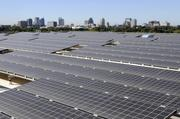"""The renovated DMV building boasts nearly 3,000 solar panels, dubbed a """"photovoltaic halo,"""" to help improve its energy efficiency."""