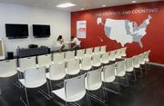 A group meeting area adds a splash of color to the white and black motif throughout much of the StudentsFirst office.