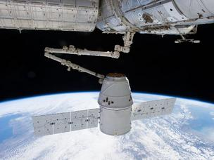 This view from the International Space Station shows the docking of the SpaceX Dragon space capsule March 3. The capsule is schedule to dock at the ISS for three weeks.
