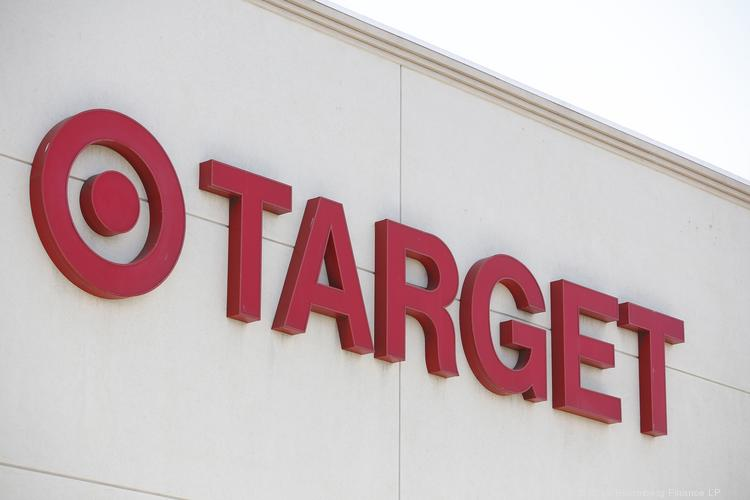 Target is reducing its corporate staff by 150 and will hire fewer seasonal employees to help with the upcoming holiday rush.