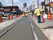 Finally, a concrete track slab will be poured and smoothed before pavers on Elm Street can be replaced.