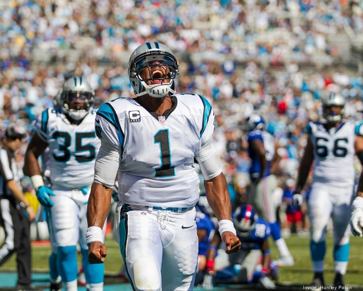 Carolina Panthers quarterback Cam Newton gives a celebratory roar after scoring a touchdown. The Panthers beat the New York Giants 38-0 in Sunday's game at Bank of America Stadium.