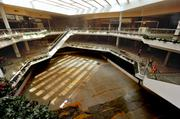 The three-story mall (including the lower level ice rink) featured a skylighted atrium with staircases and escalators. The ice rink covered and used for indoor soccer during the Mall's final years.
