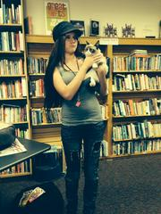 Mary Farnsworth, a Facebook contest winner who got to hold Grumpy Cat at the event.