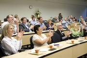 The audience at the AgStart Pitchfest applauds the Tule Technologies presentation.
