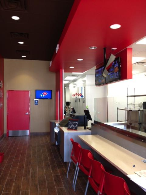 """Domino's Pizza is introducing the """"Pizza Theater,"""" where customers may watch their pizza being made."""