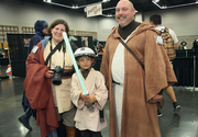 The Jedi-outfitted family of Lisa, Alex and Jason Sample of Portland takes in the scene at Rose City Comic Con.