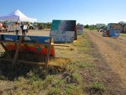 Mural panels line the walkways of the community gardens at PHX Renews.