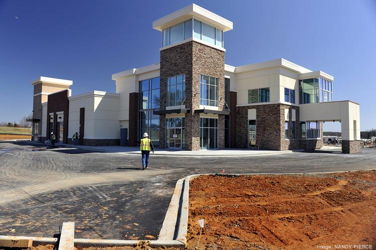 The first building to open in the mixed-use Langtree development in southern Iredell County will be a combination convenience store, gasoline station and developer's office building.