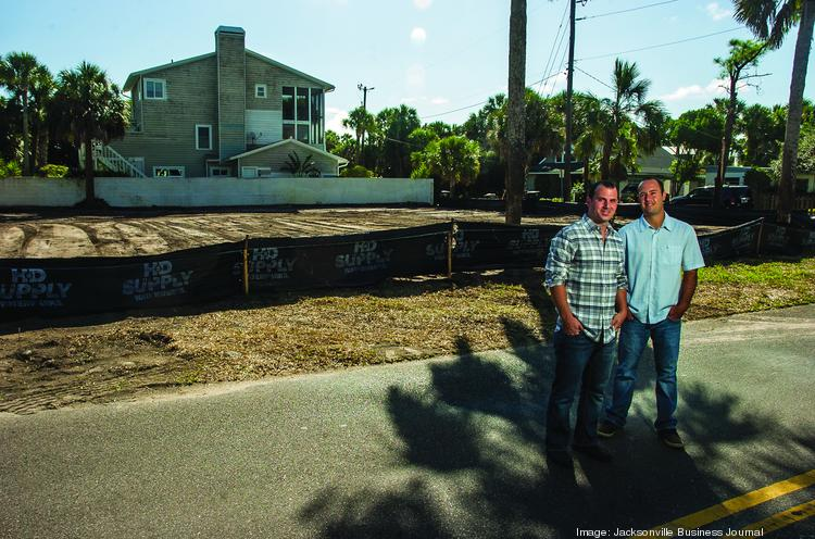 Jack Ossi, Jr., and Ben Ossi of Ossi Homes and Development at one of the company's Atlantic Beach properties.