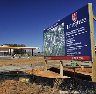 The first building to open in the mixed-use Langtree venture in southern Iredell County will be a combination convenience store, gasoline station and developer's office building.