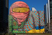 First mural on the Greenway by Os Gemeos, the two Brazilian street artists, who drew a barefoot boy wearing shrouded headgear.