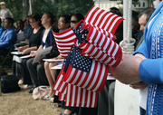 American Flags were handed out to all after they became official US citizens.