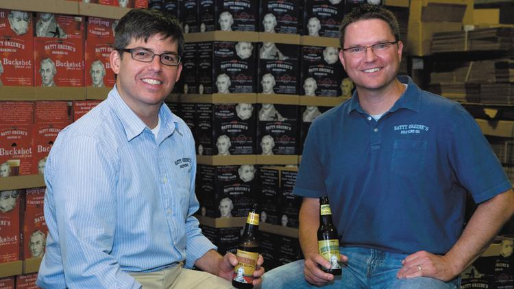 Chris Lester (left) and Kayne Fisher, the owners of Natty Greene's Brewing Co.