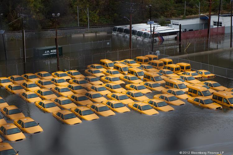 A fleet of taxis sits submerged in water in Hoboken, N.J., on Oct. 30, 2012. The Atlantic storm Sandy left a landscape of devastation across much of New Jersey, tearing apart seaside resort towns, ripping houses from foundations  and littering the turnpike with rail cars and debris.