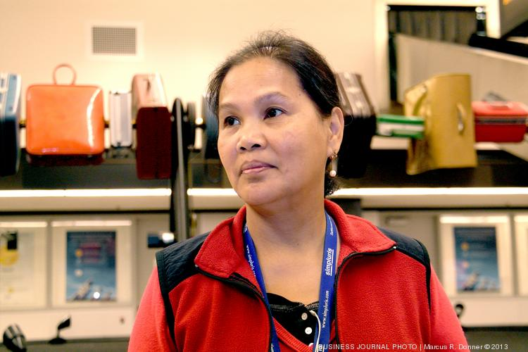 Evelyn Olano works seven days a week for two different employers at Sea-Tac Airport to make ends meet.  Olano is a baggage scanner for Flight Services & Systems making $9.25/hour and does security for Olympic Security Inc making $9.19/hour.