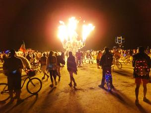 Wandering the Playa at night, our course determined by whatever shiny bright art projects catches our eye at any given moment. Of course art cars such as El Pulpo Mechanico shown here give everyone pause and light up the night sky - spewing fire and heat to much screaming and applause.
