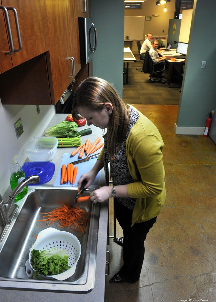 Adolphson & Peterson - No. 1 Large Company category. Sara Downing, Senior Marketing Coordinator cuts up vegetables weekly and keeps them in the refrigerator for employees to snack on.
