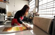 Christine Lee works on a monoprint in Pratt's print studio in Seattle's Central District.