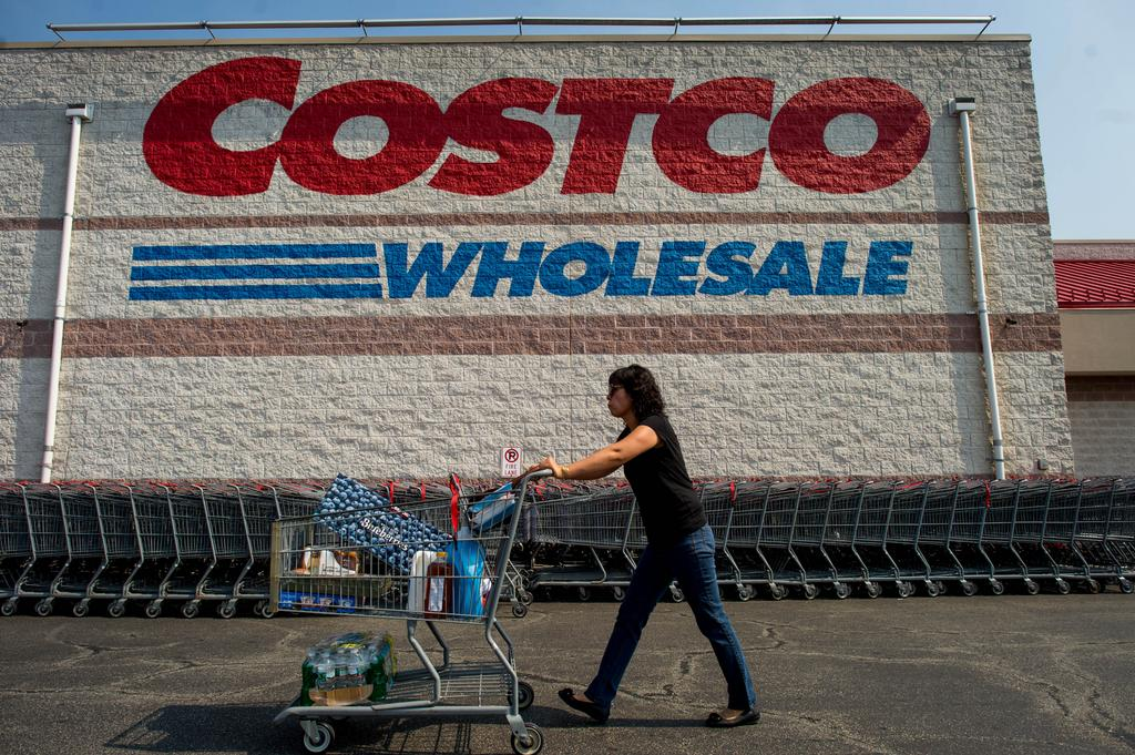 a customer pushes a cart of purchased items outside a costco wholesale corp store in
