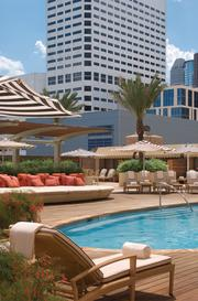 Four Seasons Hotel Houston  Bill Gates' private investment arm, Kirkland, Wash.-based Cascade Investment LLC, bought the Four Seasons Hotel Houston from St. Louis-based Maritz, Wolff & Co. in 2013 for a reported $140 million.