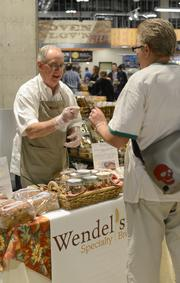 Wendel's Specialty Breads President Luke Johnson hands out samples to customers during the downtown Minneapolis Whole Foods grand opening.