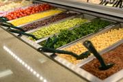 The downtown Minneapolis Whole Foods store's salad bar, with kale and edamame