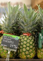 Whole Foods sells organic food, like these Costa Rican pineapples.