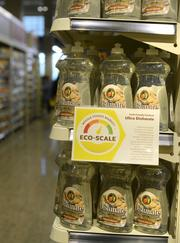 Signs around the new downtown Minneapolis Whole Foods store help customers make greener choices about cleaning products.