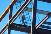 Construction crews work Wednesday on the Horseshoe Baltimore casino. The steel frame of the project is in place
