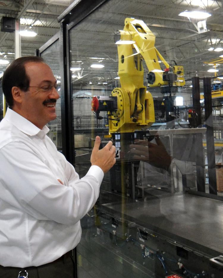 Matthew Bucherati, the senior vice president of operations for Pepsi Bottling Ventures,  describes some of the automated equipment purchased by Pepsi at the company's Union Cross facility.