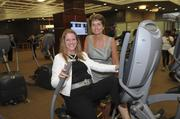 Worth NY representative Karen Simons, left, and Great Falls Construction President Stacey Hoffman try out one of the 400 pieces of new equipment.