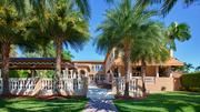 The estate features a stone railing that separates the pool, canopy and entertainment area from the yard.
