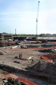 The resort pool is excavated as a crane and Dr Doom's Fear Fall loom in the background of the Cabana Bay site.