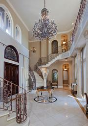 Two cascading staircases can be found at entrance of the home.