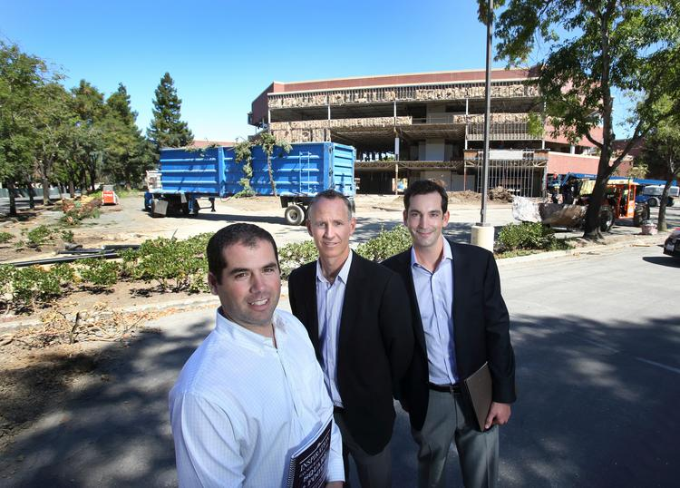 Dan Poritzky, left, and Justin Wesley of MWest, along with DivcoWest's Sam Hamilton, right, visited the Orchard Trimble Business Park in San Jose, which their group is rehabilitating.