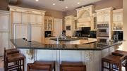 The kitchen includes marble flooring and countertops.