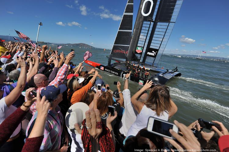Oracle Team USA crosses the finish line in San Francisco Bay to complete its defense of the America's Cup in 2013. Team CEO Russell Coutts says Hawaii is among the other venues being considered for the next America's Cup, which will be held in 2017.