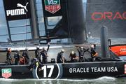 Oracle crew celebrates after crossing the finish line.